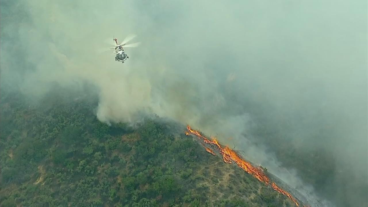 Raw video from AIR7 HD shows a brush fire burning through vegetation along Burbank hillsides on Friday, May 25, 2018.