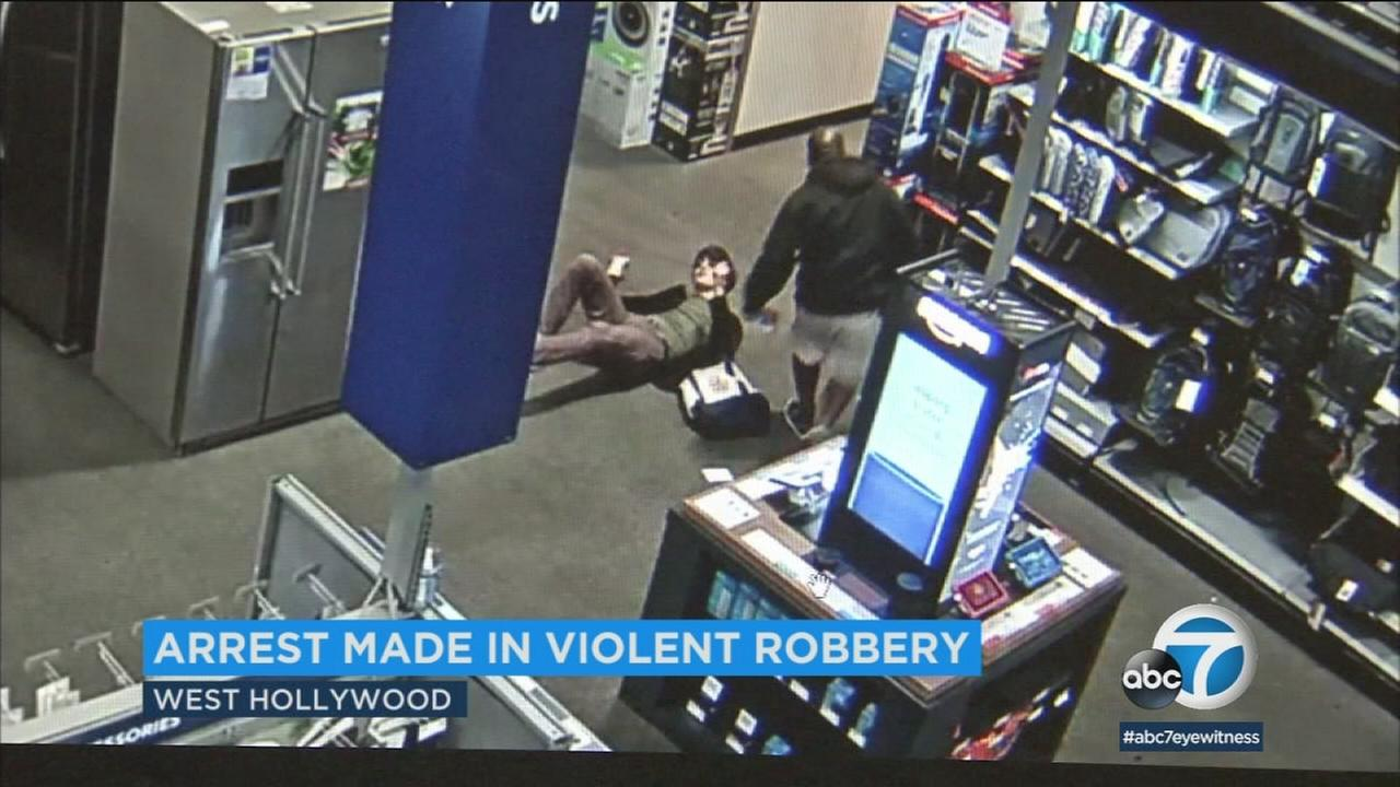 A suspect is seen hitting a man and then robbing him inside a West Hollywood Best Buy.