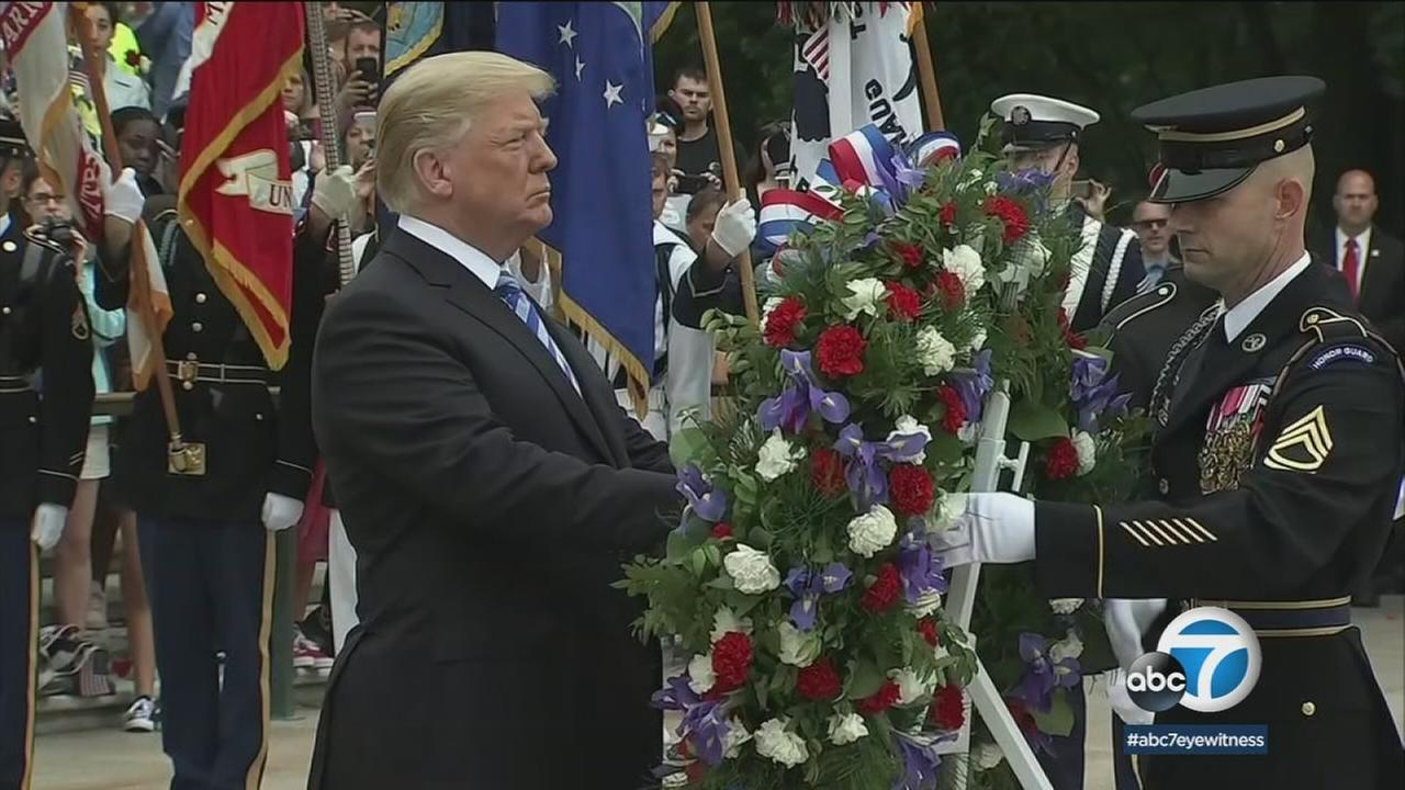 President Donald Trump lays a wreath at the Tomb of the Unknown Soldier at Arlington Cemetery on Memorial Day Monday, May 28, 2018.