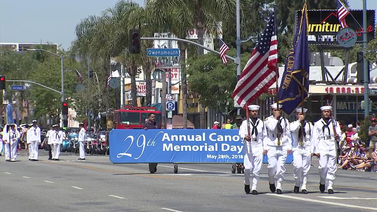 At one of several observances held across the Southland, throngs of onlookers lined Sherman Way in the San Fernando Valley for the 29th annual Canoga Park Memorial Day Parade.