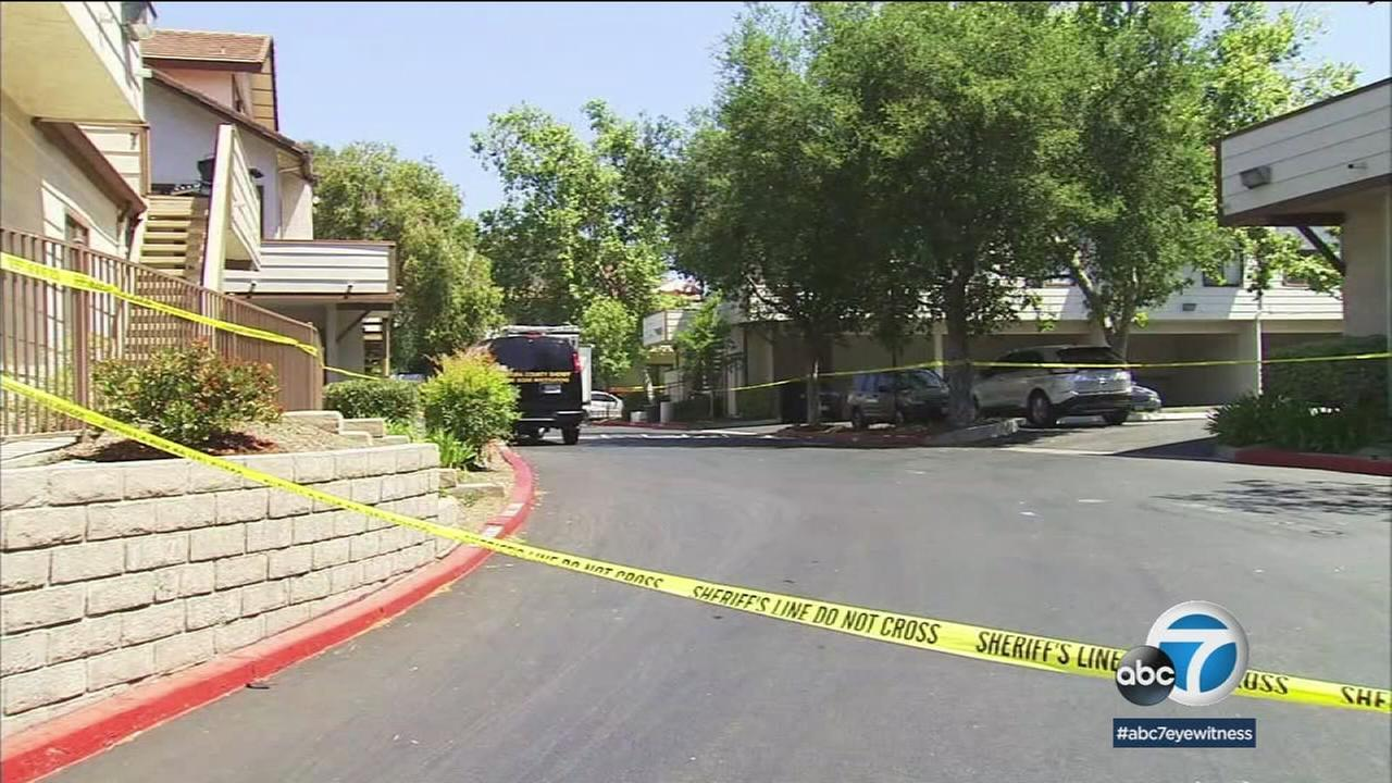 Crime scene tape cordoned off the area of an apartment building where a fatal stabbing occurred on Memorial Day.