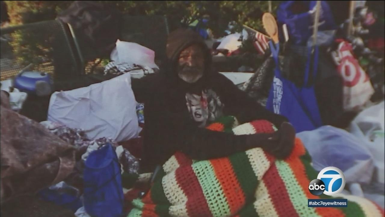 Obadiah Smith is shown in a photo at a homeless encampment in San Bernardino.