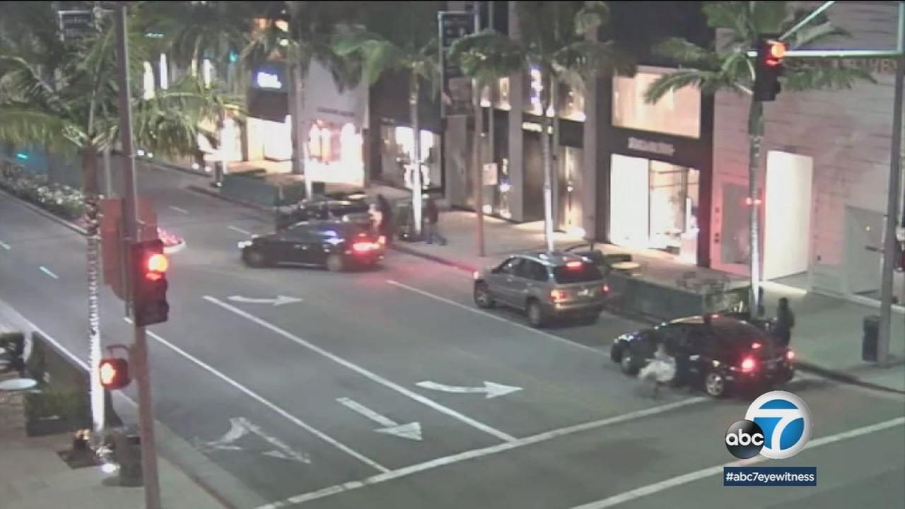 Surveillance video shows vehicles speeding off after suspects burglarized two stores on Rodeo Drive in Beverly Hills.
