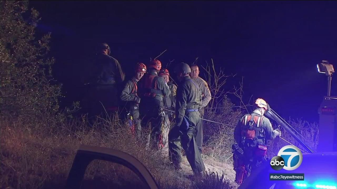 Authorities investigate the circumstances surrounding a body found near a highway in the San Gabriel Mountains in Azusa on Wednesday, May 30, 2018.