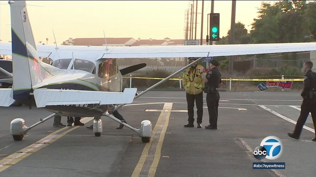 A plane in the middle of a Huntington Beach street is shown as authorities investigate the incident.