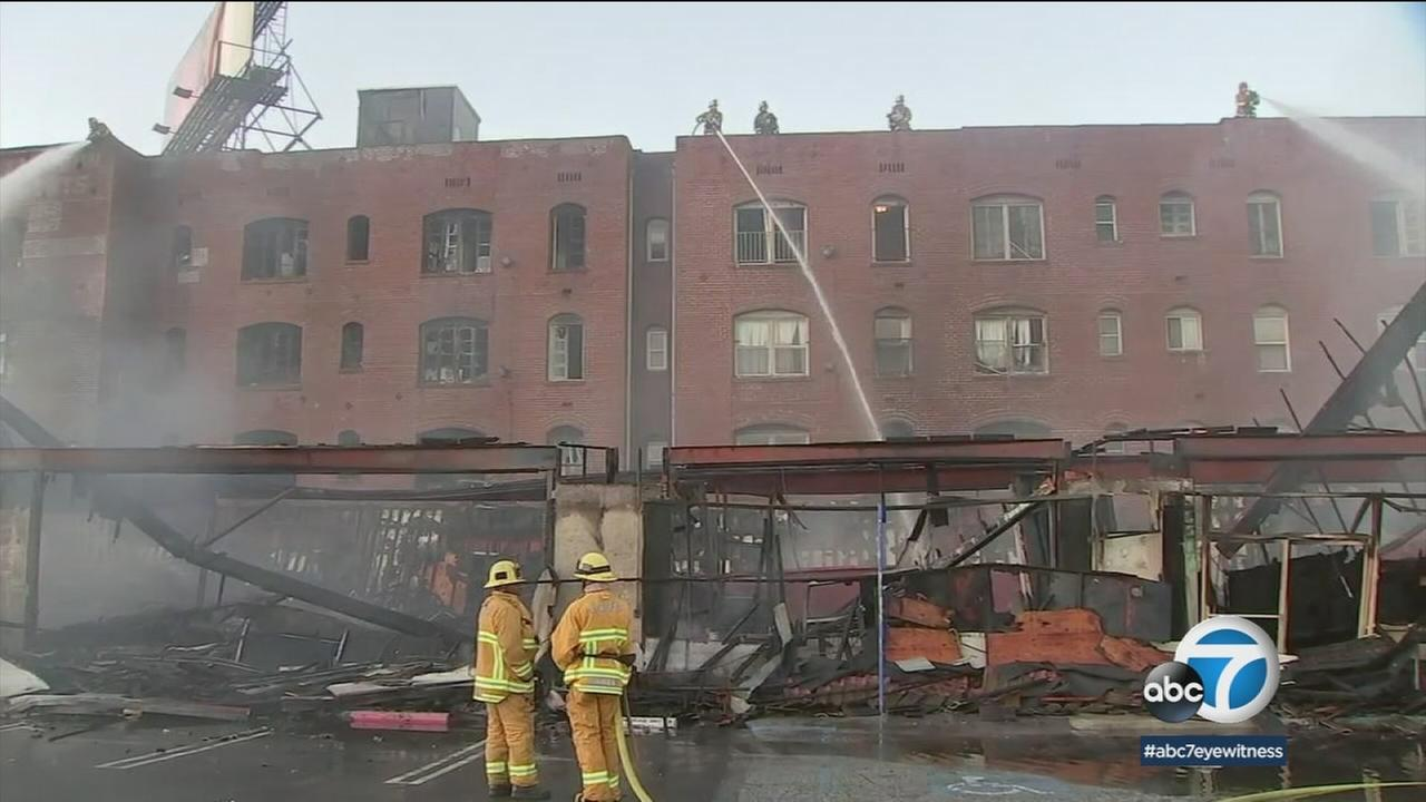 Firefighters took out hot spots in a vacant building that erupted in flames in East Hollywood on Sunday, Jun 3, 2018.