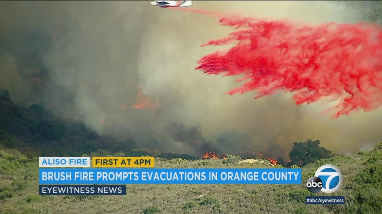 All evacuation orders were lifted for Laguna Beach residents Sunday after their homes were threatened by a wind-driven brush fire the day before.
