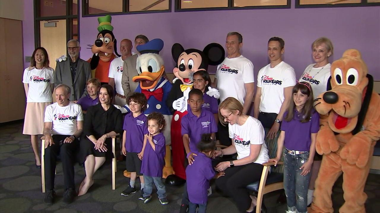 Mickey Mouse and friends visited Childrens Hospital Los Angeles as part of Disneys commitment to contribute $100 million to childrens hospitals around the world.
