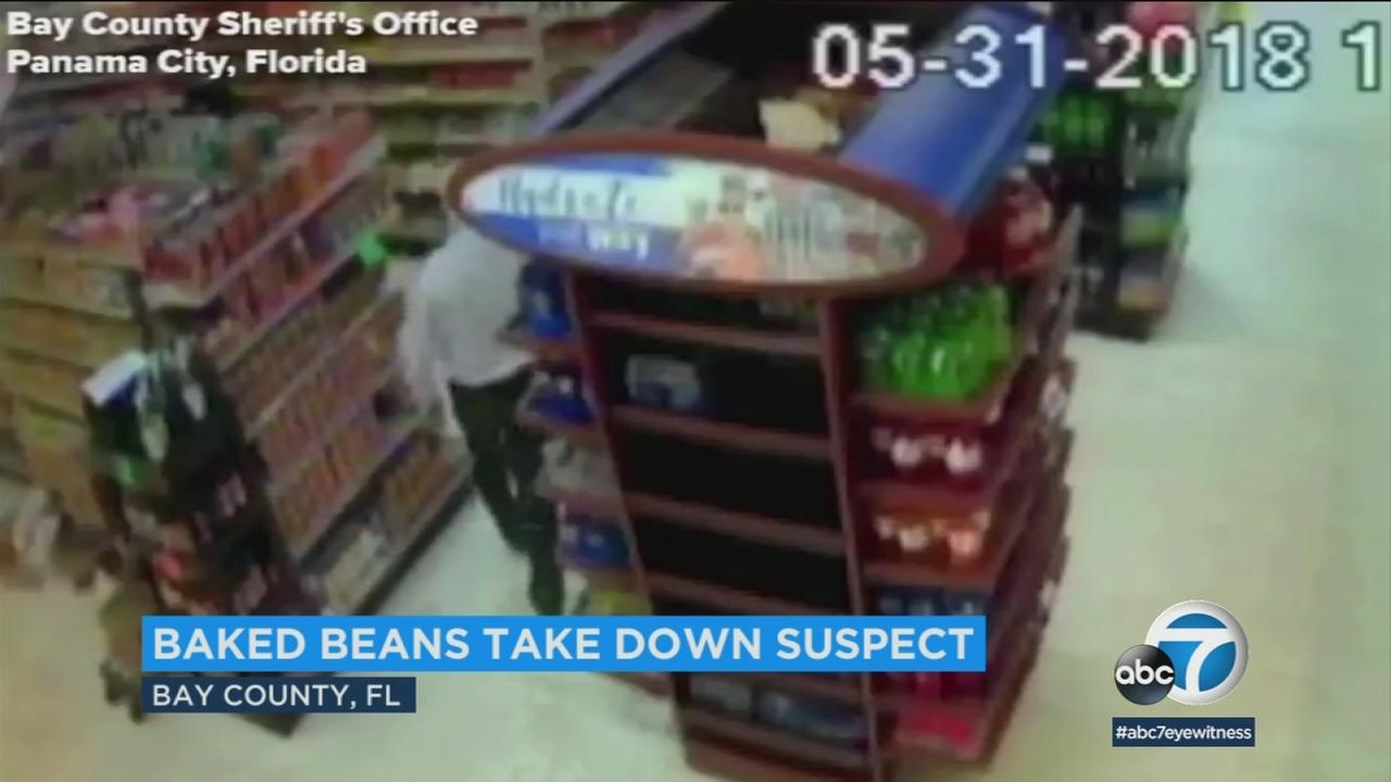 A sheriffs deputy threw two cans of beans and helped subdue a man threatening people with a hammer inside a grocery store.