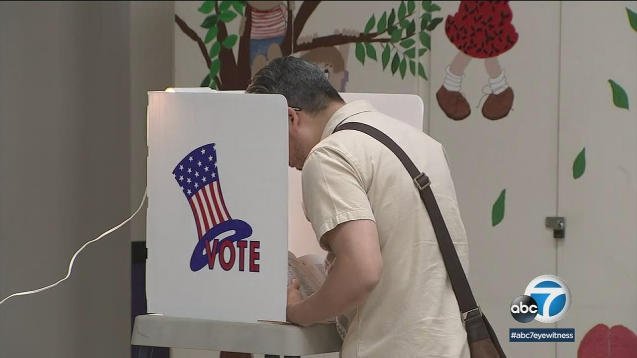 A person at a voting booth during California primary election day on Tuesday, June 5, 2018.