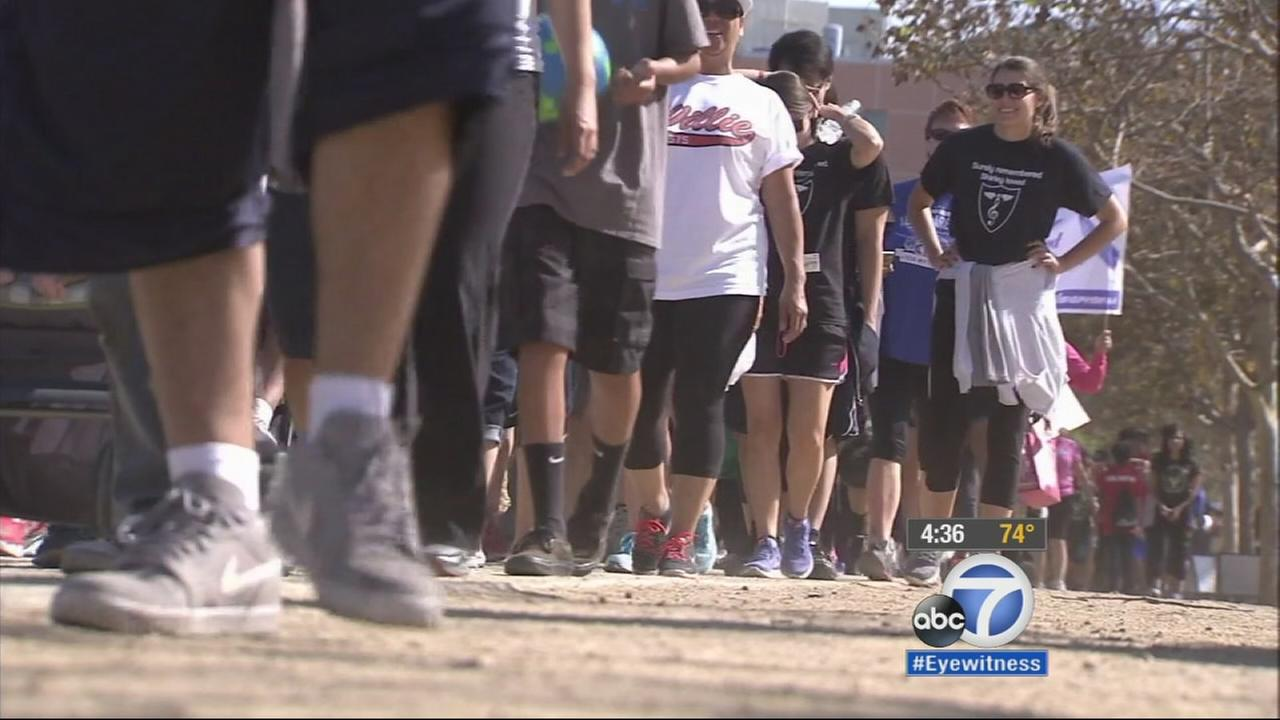 Thousands of people hit the pavement in downtown Los Angeles on Sunday for the annual Walk to Defeat ALS on Sunday, Oct. 19, 2014.
