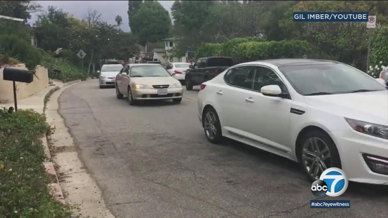 Traffic on a small and narrow Sherman Oaks neighborhood street is shown in a video captured by a resident.