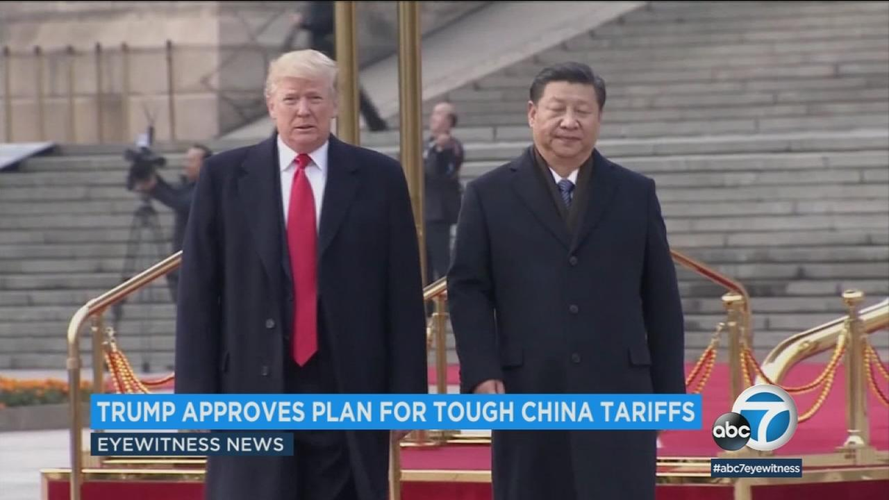 President Donald Trump walks with an official from China in this undated photo.