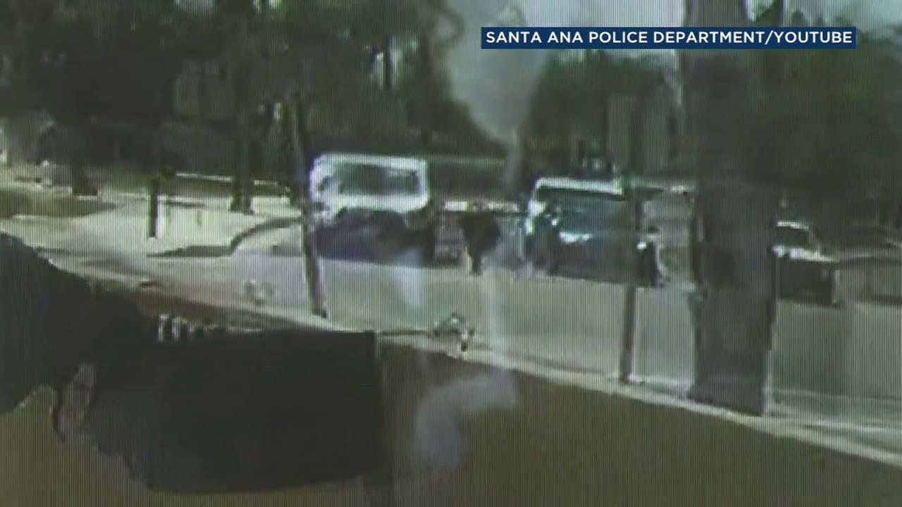 A surveillance image shows a van striking a woman in the street in Santa Ana.