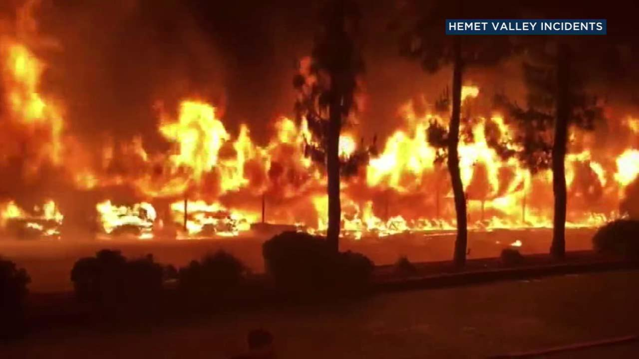 A carport in Hemet is seen engulfed in flames on Friday, June 15, 2018.