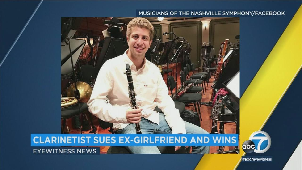A clarinetist who thought he had been turned down by a prestigious music school in Los Angeles has been awarded $260,000 after learning that his girlfriend faked the rejection letter.