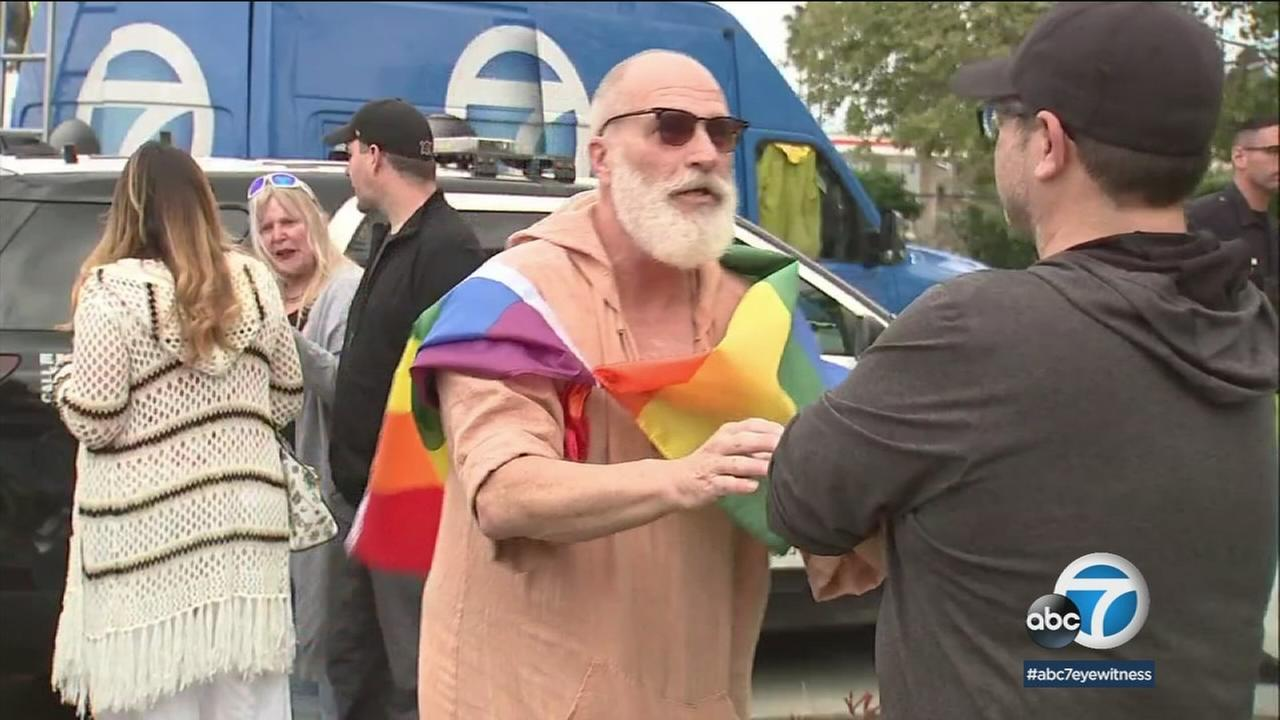 A rainbow flag now flies in San Pedro, as the community rallies behind a gay man being harassed by his neighbors.