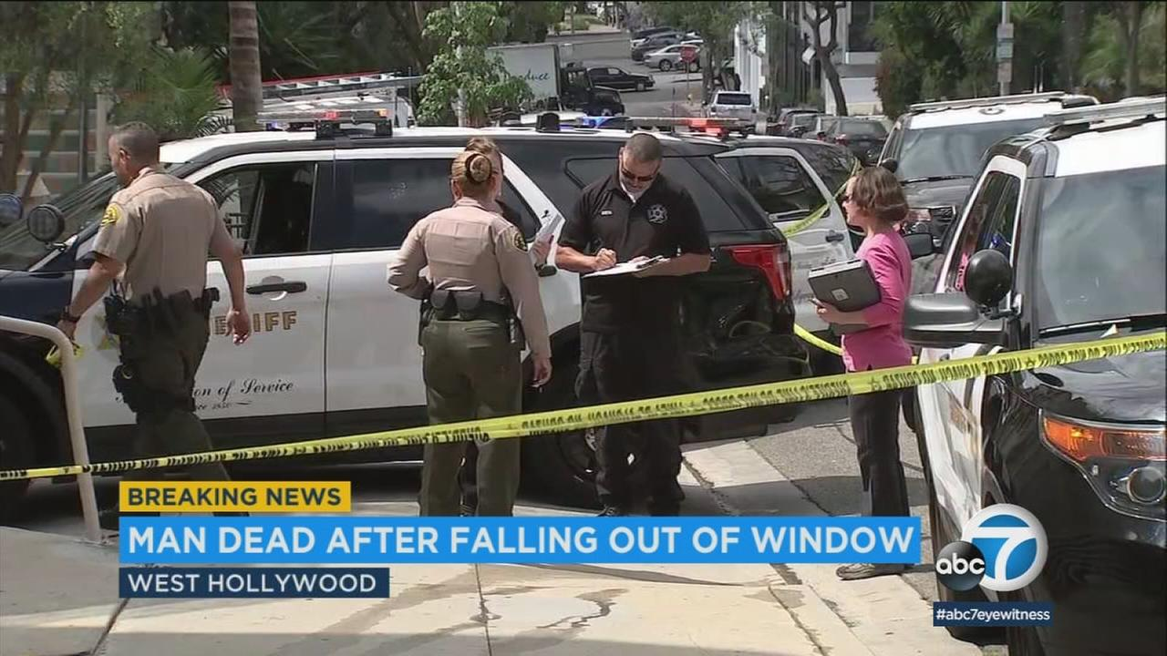 Authorities investigate a mans death after he fell out of a West Hollywood apartment window on Monday, June 18, 2018.