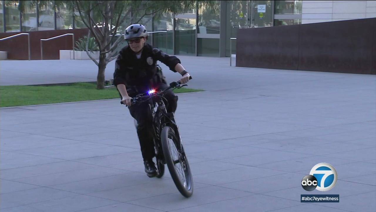 The LAPD is adding 20 e-bikes, which provide power-assisting pedaling for speeds up to 28 mph, to its bicycle patrols.
