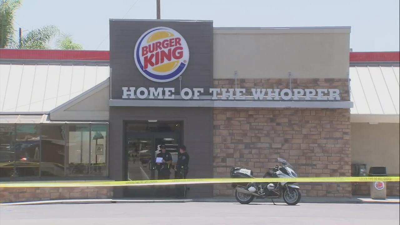 Crime scene tape ropes off a Burger King in Burbank, where a man was stabbed in an attack on Tuesday, June 19, 2018.