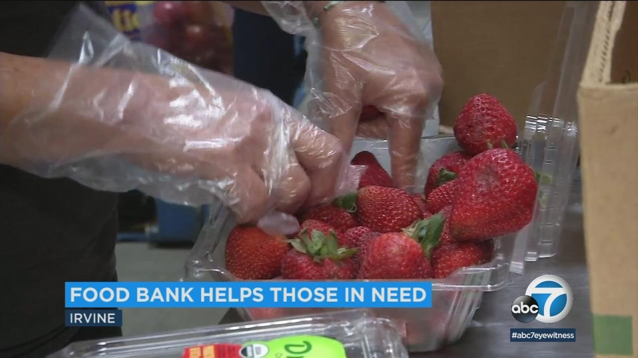 Workers at Second Harvest Food Bank of Orange County pack strawberries.