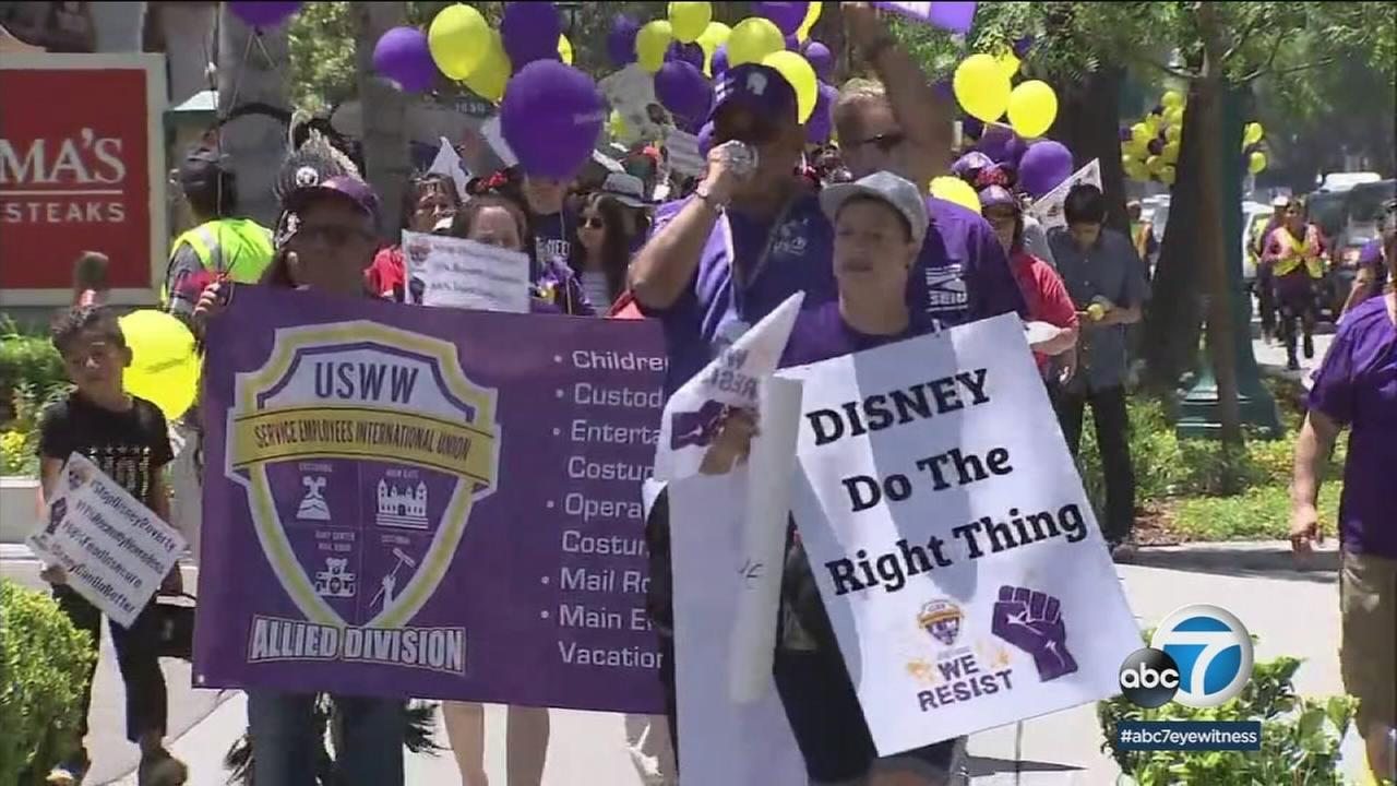 Union and Disneyland workers held signs asking the company to do the right thing in terms of higher working wages.