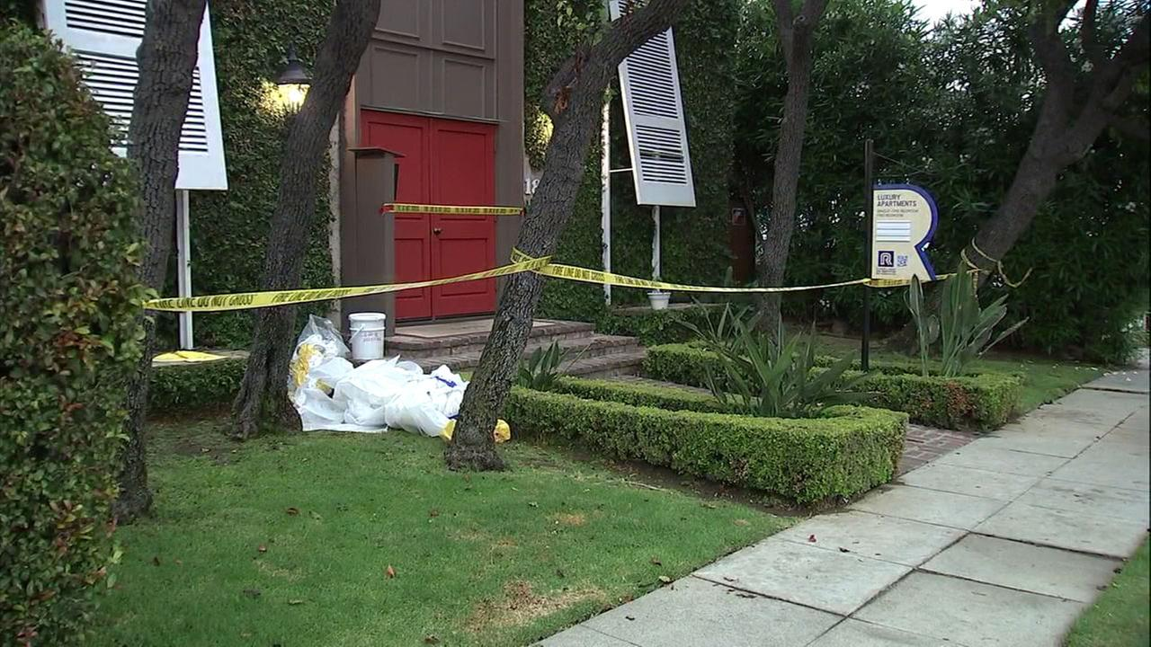 A 12-unit apartment complex is shown tapped off after it was determined that all but one unit was contaminated with asbestos in West Los Angeles.