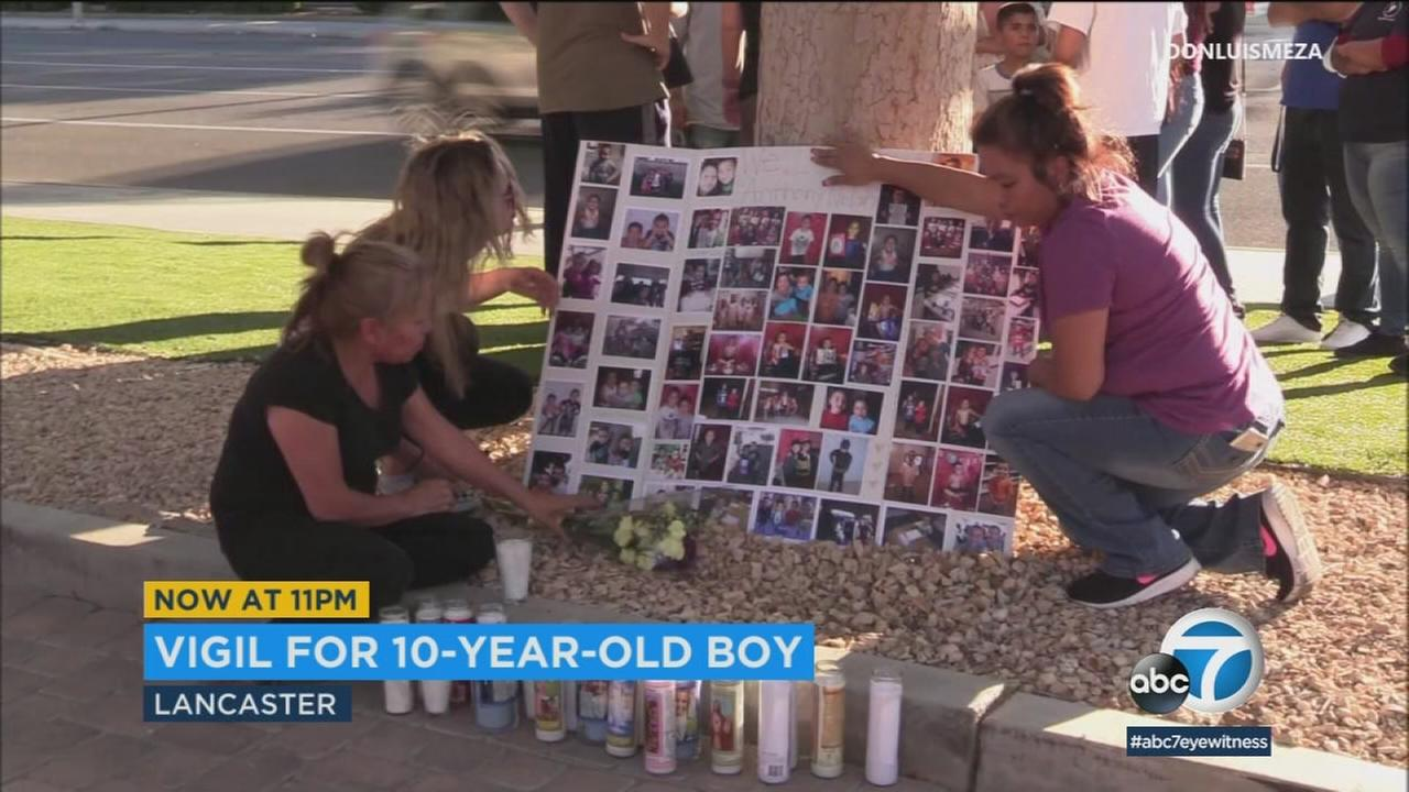 Community members held a vigil for a 10-year-old boy who died as a result of what investigators are calling a suspicious fall inside a Lancaster apartment.