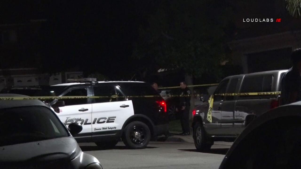 Authorities surrounded a home in Fontana where a suspected murder-suicide took place overnight.