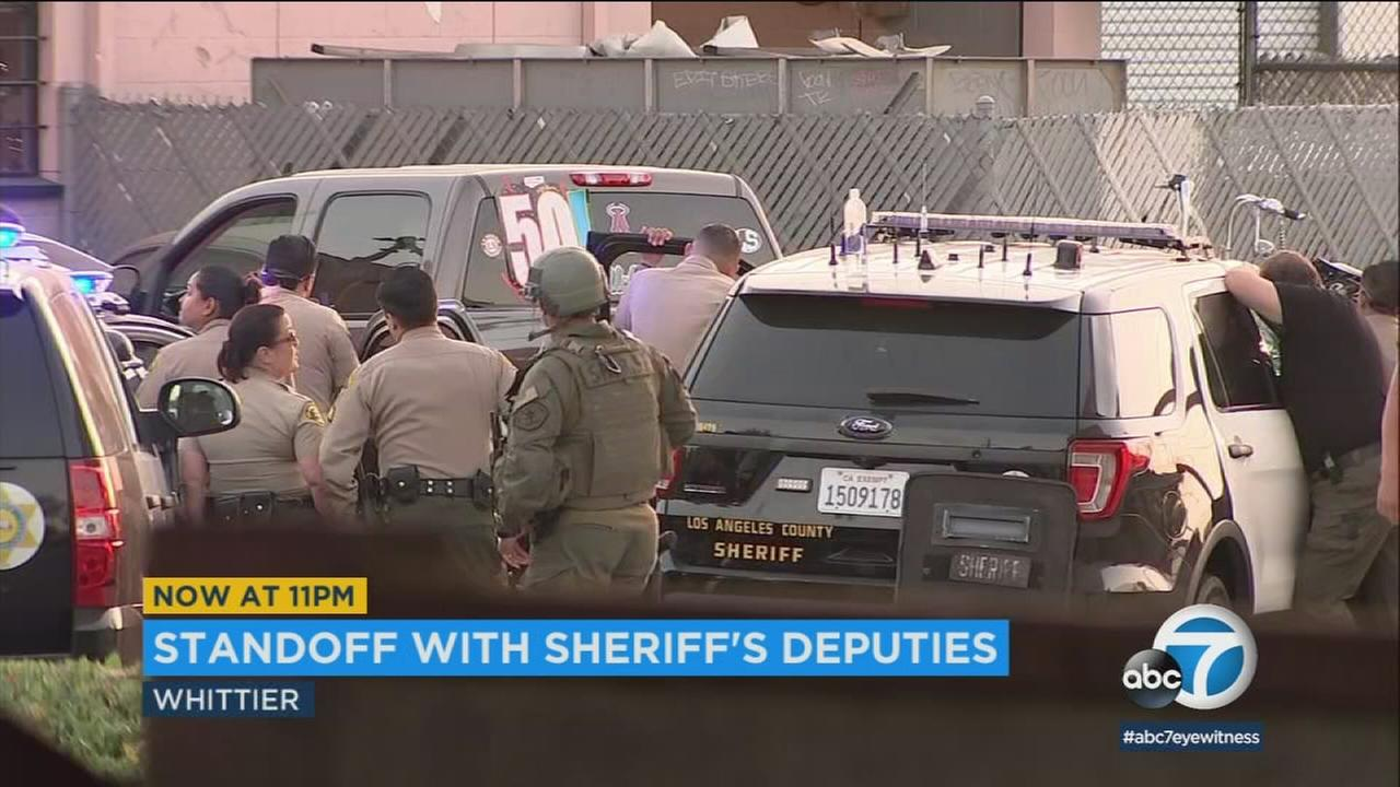 L.A. Sheriffs Department deputies were in a standoff Saturday evening in Whittier with a woman accused of assaulting her neighbor.