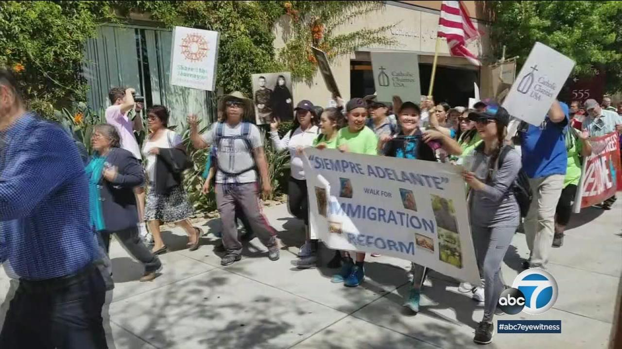 A group of churchgoers in Orange County made a 50-mile pilgrimage to downtown Los Angeles where a mass was held to show support for the nations immigrants.