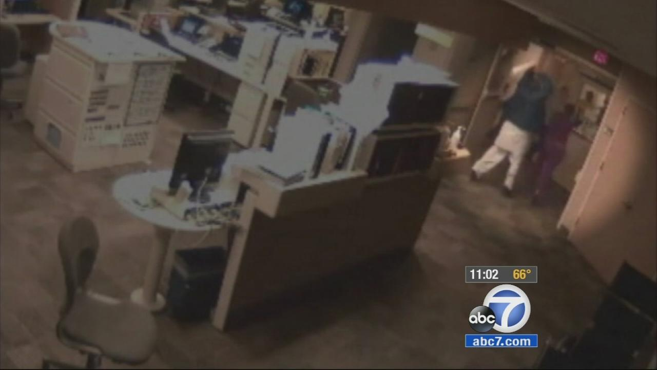 Surveillance video shows a male patient attempting to attack nurses with a metal pipe.