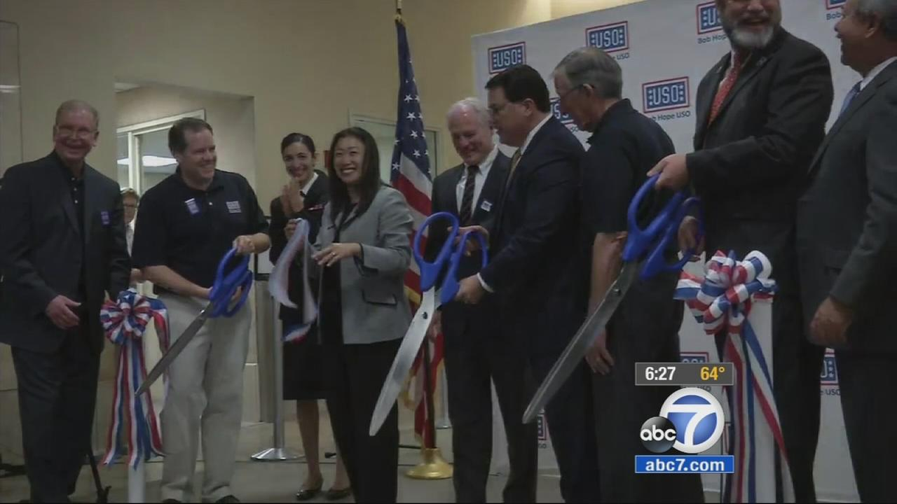 Officials cut the ribbon for the Bob Hope USO in Terminal B of John Wayne Airport in Orange on Monday, Nov. 10, 2014.