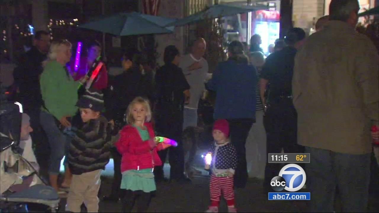 Participants of San Pedros neighborhood watch walk to the Corner Store on Monday, Nov. 10, 2014.