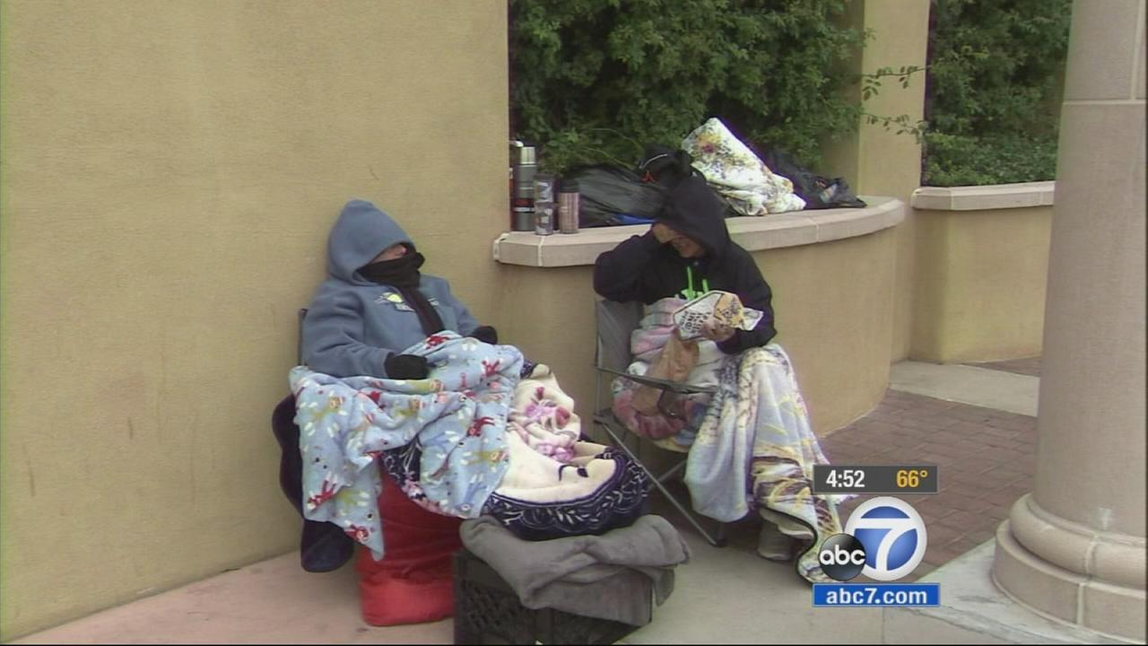 Vicky Torres and her friend Juanita Alva wait outside a Best Buy in Beaumont in preparation for Black Friday.