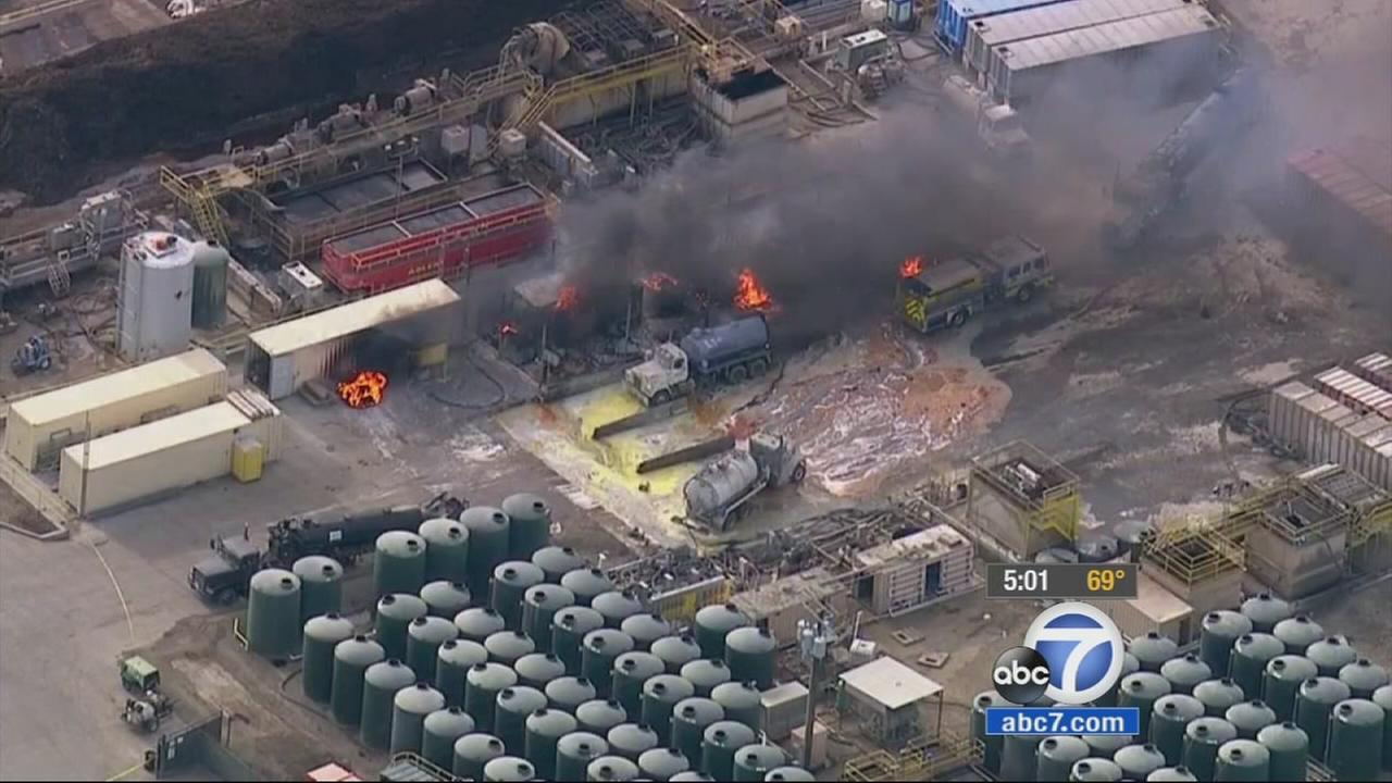 A fire continued to burn and explosions were still occurring at a wastewater facility near Santa Paula hours after a vacuum truck exploded.