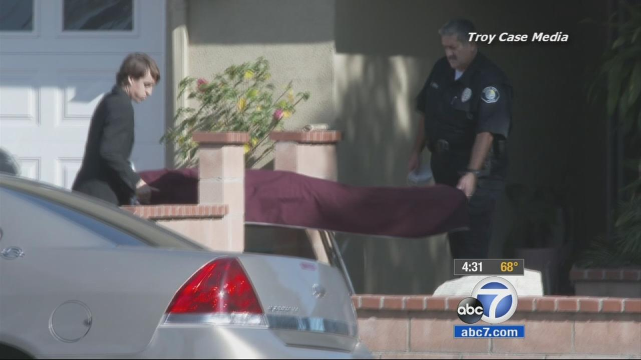 Authorities take the body of a 2-year-old boy from his Santa Ana home on Saturday, Nov. 22, 2014.