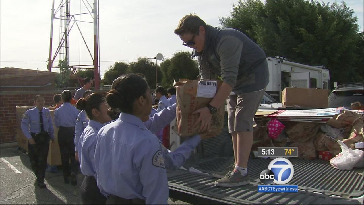 Several trucks full of donated goods were delivered to the Los Angeles Police Departments West L.A. station as part of a food drive on Sunday, Nov. 23, 2014.