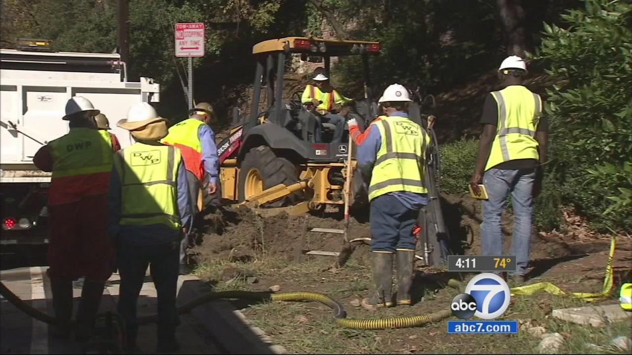 Crews repair a water-main break on Benedict Canyon in Beverly Hills on Tuesday, Nov. 25, 2014.