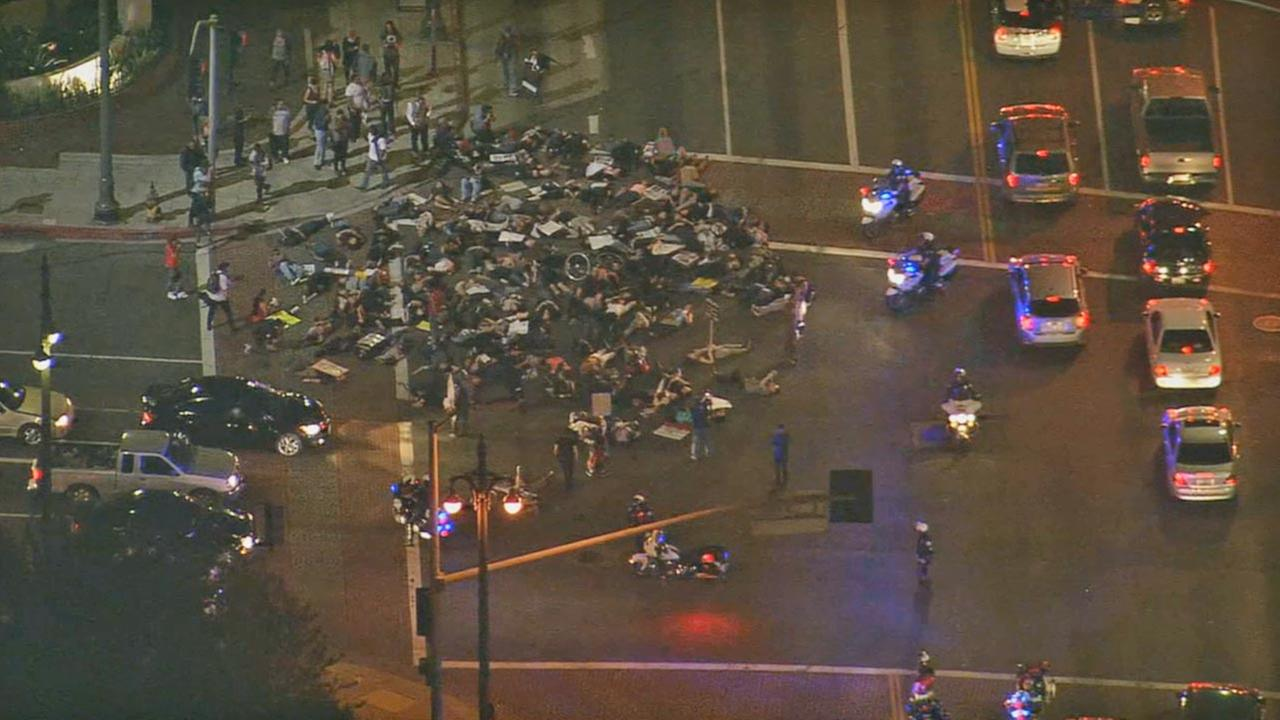 Protesters lie down in traffic at Cesar Chavez and Alameda in downtown L.A. at about 5:30 p.m., Wed., Nov. 26, 2014.