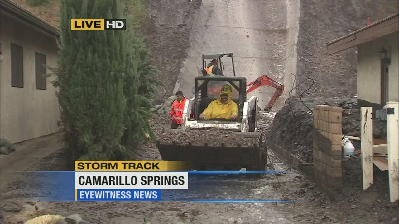 Crews clean up after a mud flow swamped a Camarillo Springs neighborhood on Tuesday, Dec. 2, 2014.