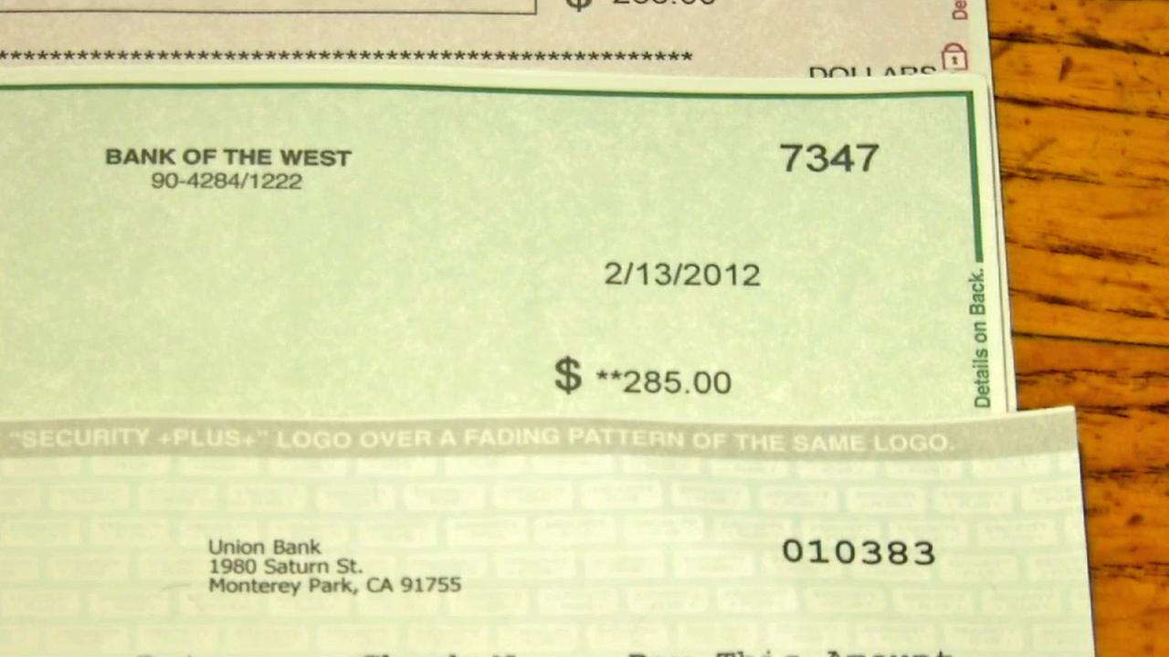 Checks that arrived in the mail two years late to a man in Garden Grove are seen in this photo from Dec. 2014.
