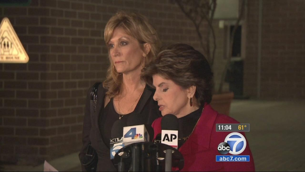 Judy Huth is seen with her attorney, Gloria Allred, at a press conference on Friday, Dec. 5, 2014.