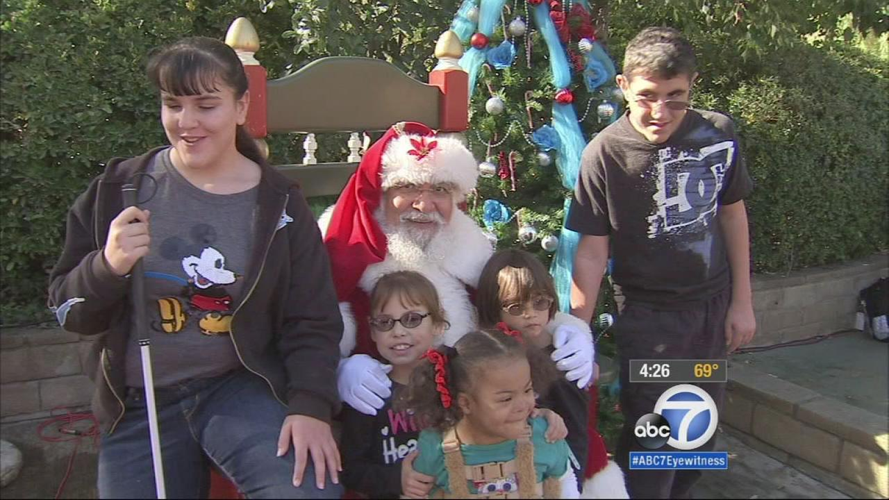 Children sit with Santa at a holiday celebration held at Six Flags Magic Mountain on Saturday, Dec. 6, 2014.