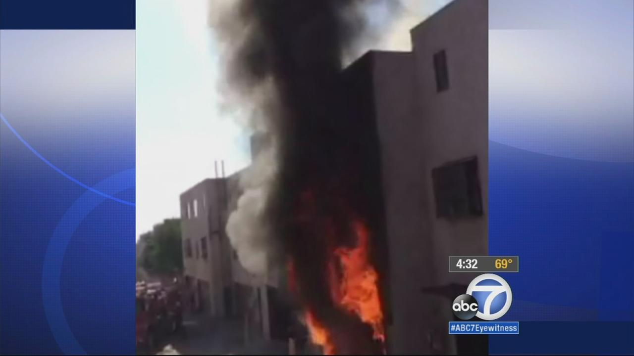 Flames destroy a three-story condominium home on Saturday, Dec. 6, 2014.