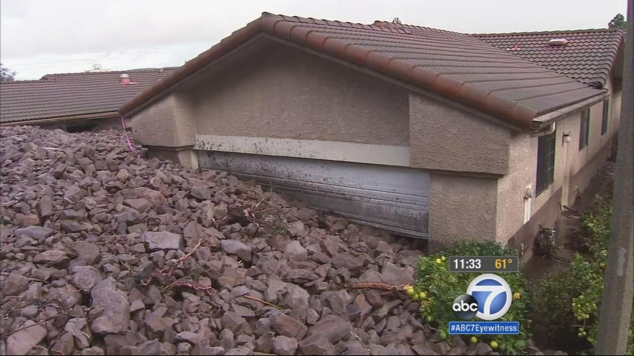 Debris flowed into homes in Camarillo Springs on Friday, Dec.12, 2014.
