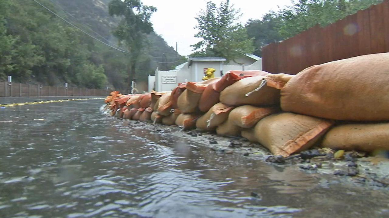 Sandbags line a street in Silverado Canyon on Friday, Dec. 12, 2014.