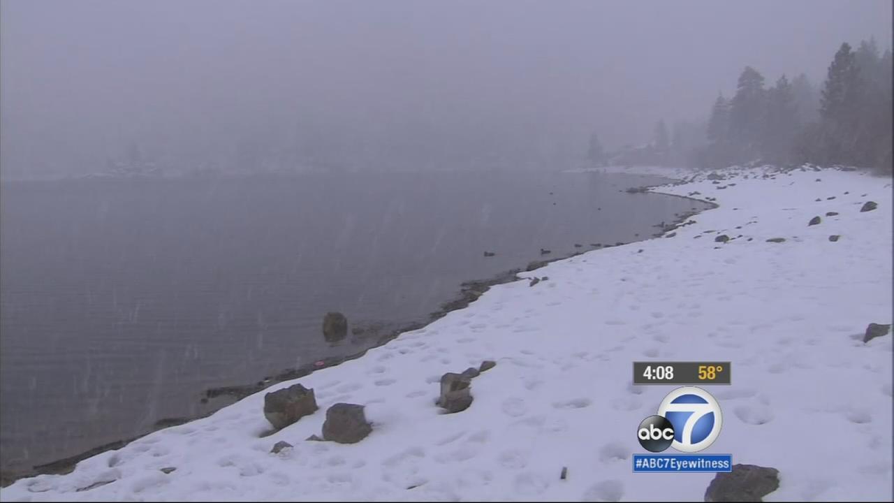 Snow falls at Big Bear Lake on Tuesday, Dec. 16, 2014.