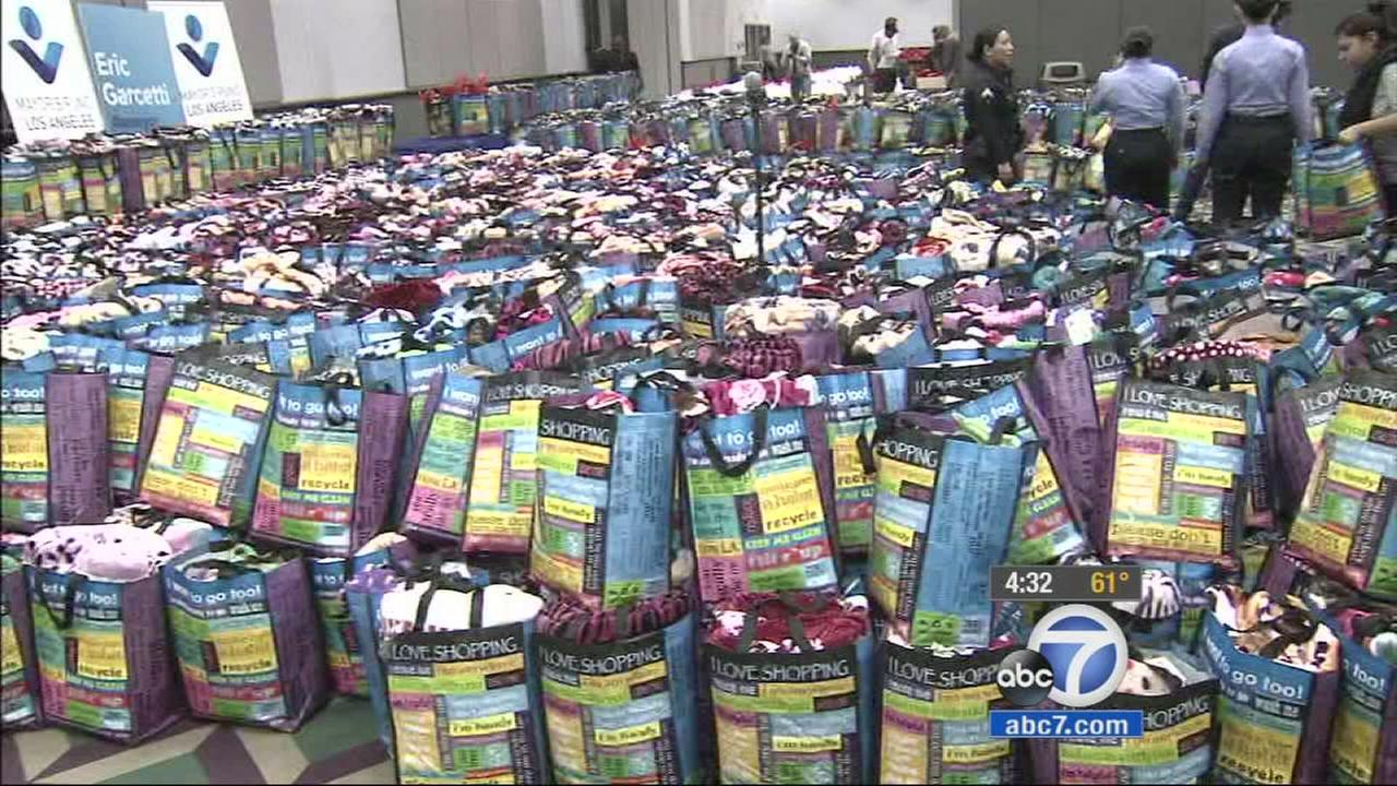 Volunteers all over Los Angeles came out to stuff 4,500 gift bags for seniors after the original gift bags were damaged in the downtown apartment fire.