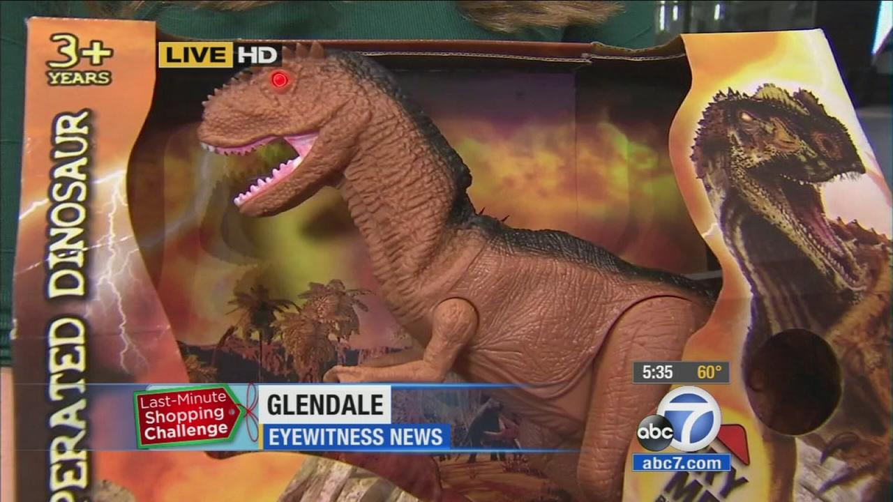 A dinosaur toy is picked up for a patient at Childrens Hospital Los Angeles for the holiday season.